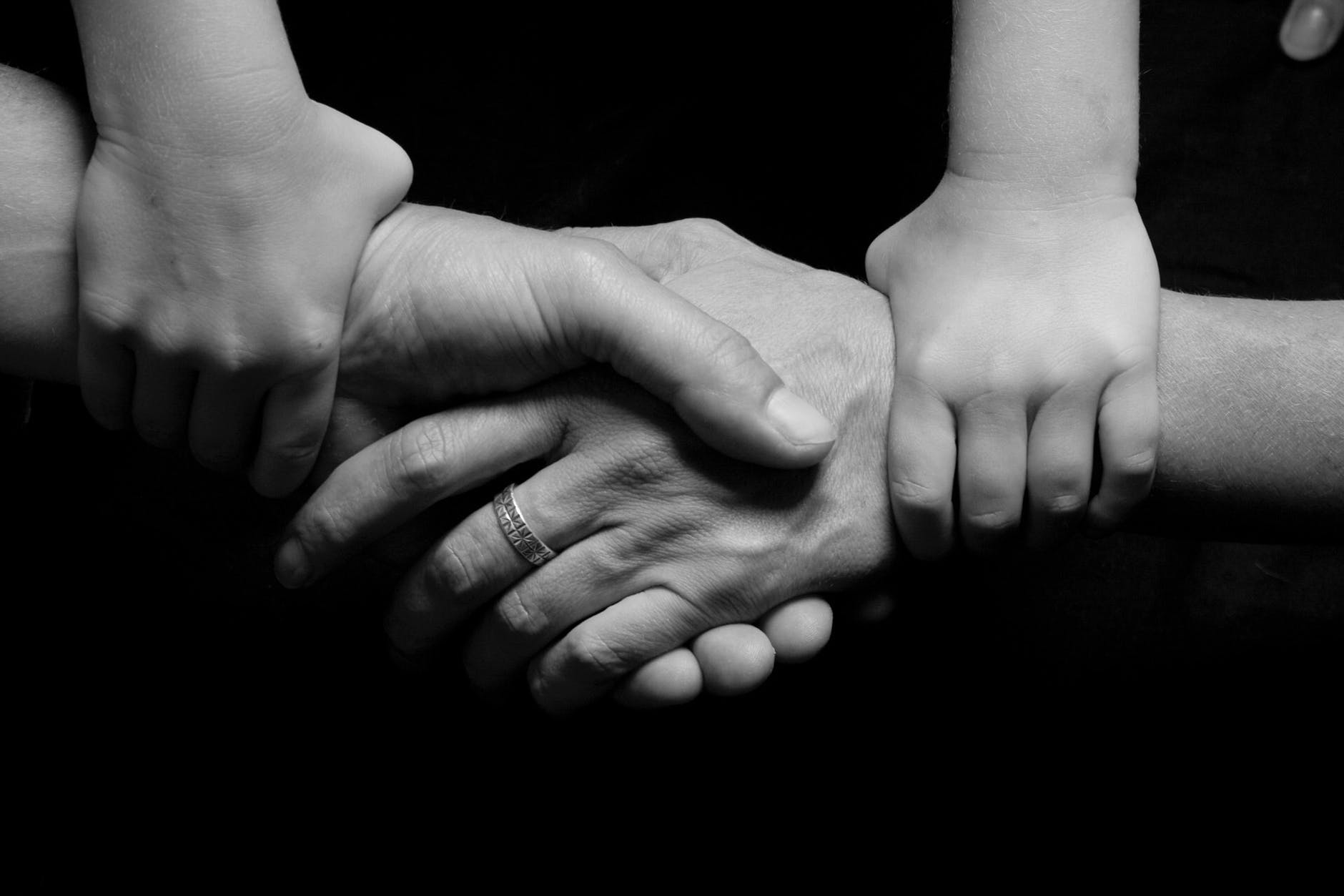black and white connected hands love